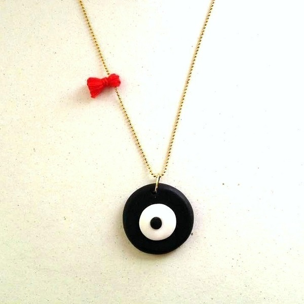 Evil eye and red tassel necklace
