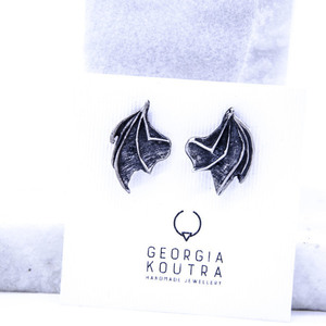 ''Batman'' stud earrings