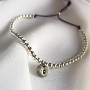 "Initial"" bracelet with silver plated beads and alpaca hand stamped letter"